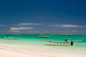 boats on turquoise water by archaeopteryx-stocks