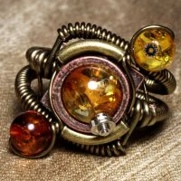Amber Orbit steampunk ring by CatherinetteRings