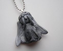 Weeping Angel- Doctor Who Custom Necklace by RavenMedia
