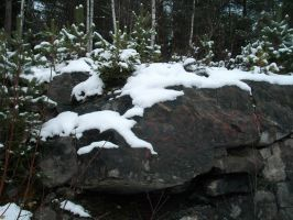 Snow and rock by migartSTOCK