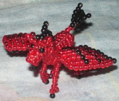 Beaded red winged unicorn by Anabiyeni