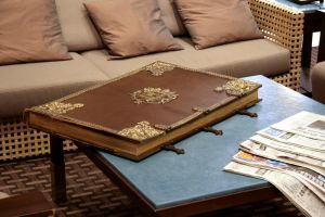 Huge old leather book on table by barefootliam-stock