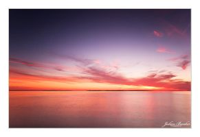 Manitou Islands During Sunset by Julian-Bunker