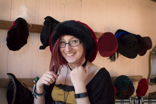 Trying on Hats by WazoskiPhotography