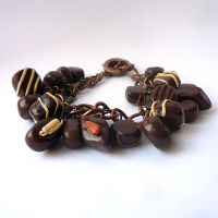 Chocolate charm bracelet by drrtymagic