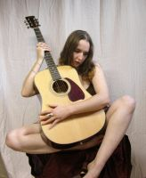 Girl with guitar by sullenstock