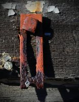 Rusted thing on the side of the abandoned house by PAlisauskas
