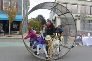 The Human Hamster Wheel Rolling Down the Street 10 by Miss-Tbones