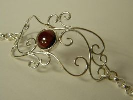 Sterling Silver Garnet Scroll Braclet by gokusonwing0
