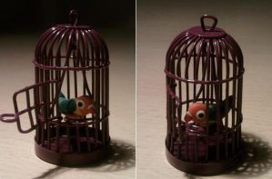 Little cage with parrot fimo by bimbalove81