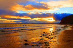Sunset On Sandy Bay at Littleham Devon England by TheMagikArtist
