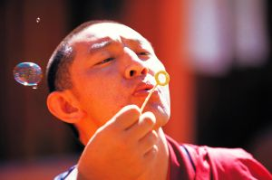 Monk blowing a bubble by sharadhaksar