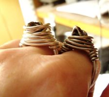 2 wrapped skull rings side view by artefaccio
