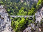 bridge in mountains by puddlz