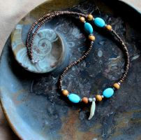 Otter Tooth Necklace by lupagreenwolf