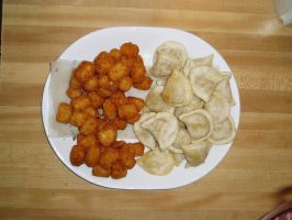 Perioges and Tots on a plate by nitch-stock