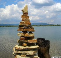 Driftwood and stone balance by tamas kanya by tom-tom1969