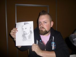 Don at Crypticon holding Quick Drawing I by Poorartman
