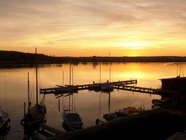 Sunset at a harbor by Olessa