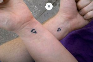 Nadja and I have matching Internet Heart tattoos by benchilada