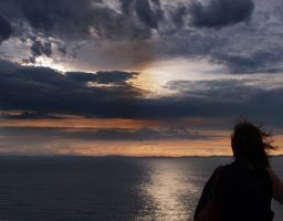 a silhouette at sunset by VaggelisFragiadakis