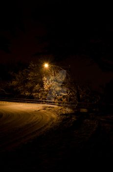 Darkness on a snowy street by MMalonephotography