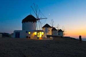 Couple In Front Of The Windmills - Mykonos by EasyGreasy