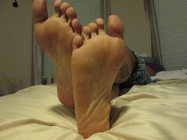 Crossed ankles soles view by boosters