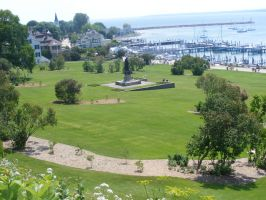 Jaques Marquette statue and Mackinac Island Harbor by Were-Owl