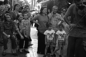 Double Twins watching street band by TanBekdemir
