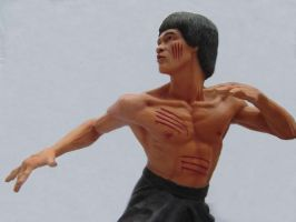 Bruce Lee figure painted cast by Alaneye