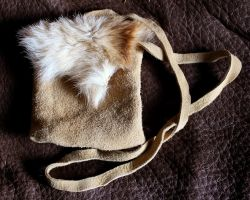 Jackal fur and elkskin pouch by lupagreenwolf