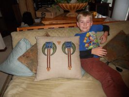 Finished American Beauty Pillow with son for scale by dragondoodle