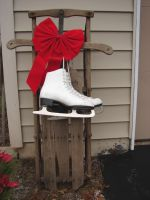 Ice Skates Red Bow Sled by FantasyStock