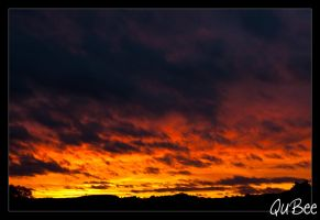 fiery sunset by QuBee24
