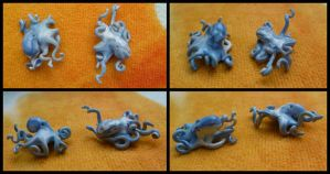 Blue octopi earrings by ZutaraMushroom