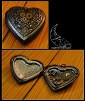 locket: heart one by TheClockworkCrow