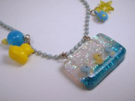 Duckies in a Row Under Resin pendant by PoniesOfDOOOM