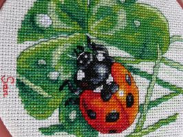 Ladybug in cross stitch by Santian69
