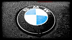 wet BMW Symbol on the hood by DimitriBokowPhoto