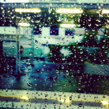 Rain on a train by PoppyHunter