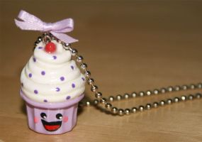 Purple Cupcake With Cherry On Top by jbphillips
