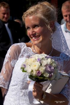 Smiling bride with flowers by julje
