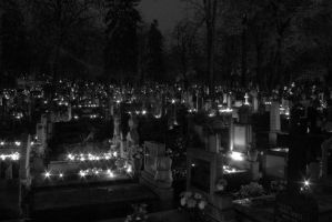Cemetery lit by candles by DarkSideOfTheLens