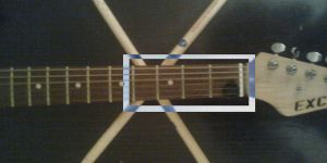 Guitar Neck and Crossed Drumsticks by thatmadfinnishguy