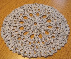 5 1/4 Inch Lacy Doily with Raised Stitch Center by doilydeas