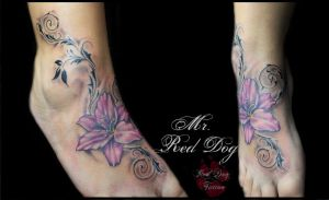 Lilys and swirls by Reddogtattoo
