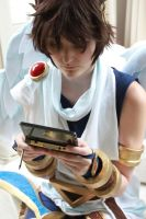 Pit playing Nintendo 3DS by Medowsweet