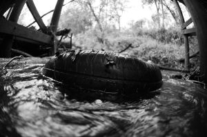Tire in creek 2 by lamorth-the-seeker