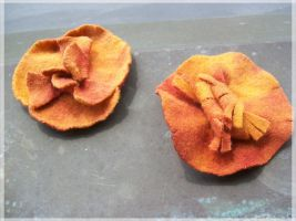 Orange flower brooches by cayra